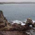 Arched rock with Pambula Beach in background (108205)