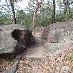 Walking between boulders towards Red Hands Cave (145446)