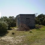 Historic concrete building on coast cemetery trail (17973)