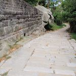 Sandstone wall and old Cobblestone Rd (255914)