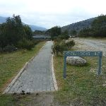 Bullocks Hut sign pointing towards rail bridge (295122)