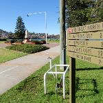 Great North Walk sign post pointing to; Newcastle Warners bay Sydney Cove and Teralba Rail (66153)